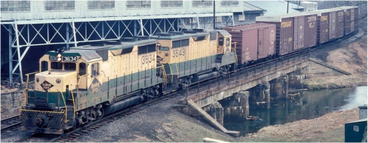 On March 5, 1976, a few weeks before the advent of Conrail, a pair of GP-35s hauls train RW-5 along the Reading's Wilmington & Northern Branch at Valley, PA, just north of Coatesville.  The hi-cube boxcars contain auto parts for the GM plant in Wilmington.  Photo courtesy of Richard W. Jahn.