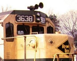 A detail view of the electronic bell on the short hood of Reading GP-35 #3638.